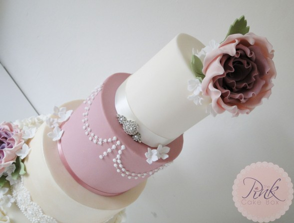 dusky-pink-rose-wedding-cake-pearls-ruffles